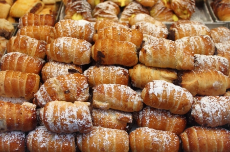 cannoli pastry: Tray of cannoli with cream for sale in a pastry shop