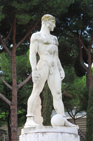 manful: Statue of a soccer player in the Marble Stadium of Rome, Italy
