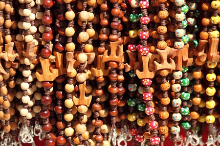 franciscan: Colorful beads with tau cross, the franciscan symbol