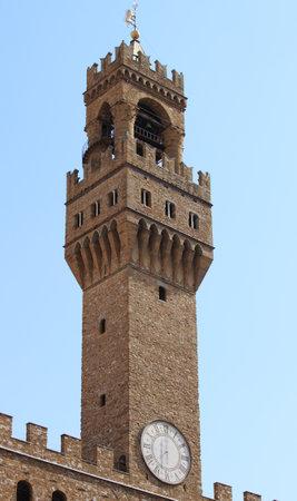 signoria square: Tower of Palazzo Vecchio in Signoria Square of Florence. Italy Editorial