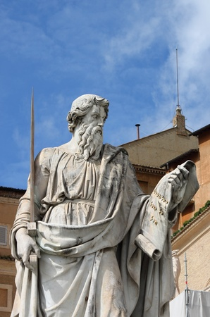 Statue of Saint Paul the Apostle with the chimney of Sistina Chapel on the background  Vatican City State photo
