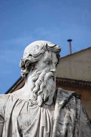 Statue of Saint Paul the Apostle with the chimney of Sistina Chapel on the background. Vatican City State photo