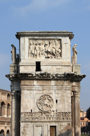 Lateral side of Arch of Constantine in Rome, Italy photo