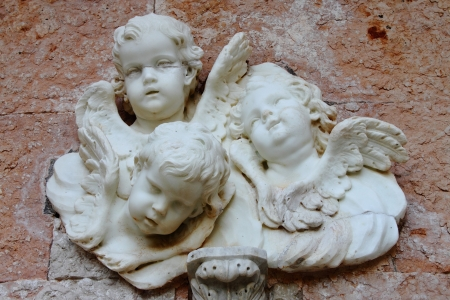 sculpt: Basrelief from old building depicting three small angels