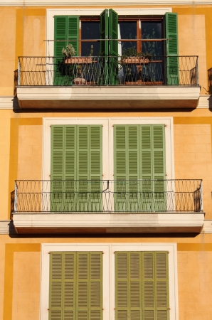 Palma de Mallorca, Spain - May 22, 2012: Squared windows with closed shutters and balconies