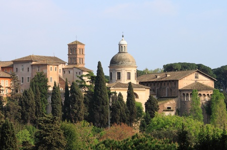 Urban scenic of Rome with dome and churches photo
