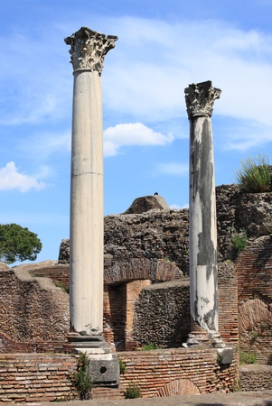 Columns of an ancient roman temple in Ostia Antica, the old harbour of Rome, Italy photo