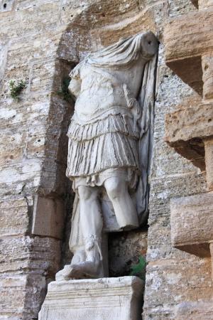 beheaded: Roman statue at the entrance of Dalt Vila in Ibiza town, Spain