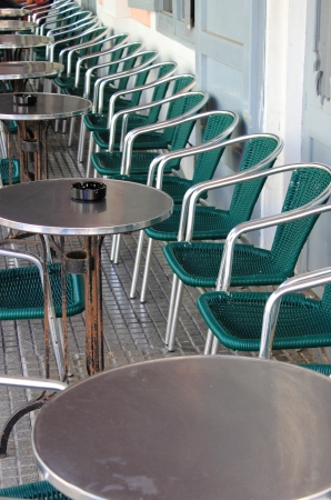 Row of empty bar tables and chairs and with vintage look photo