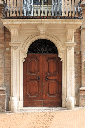 Wooden renaissance style front door photo