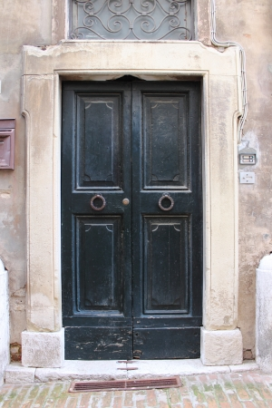 Wooden medieval squared style front door photo