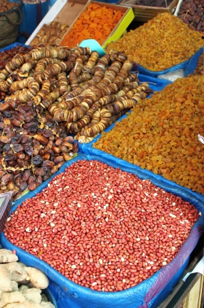Dried fruits and legumes at a market stall in Morocco photo