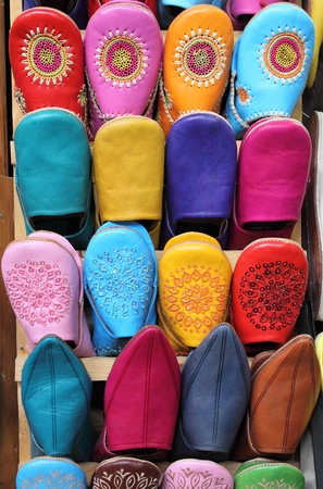 Leather moroccan slippers for sale in a market stall photo