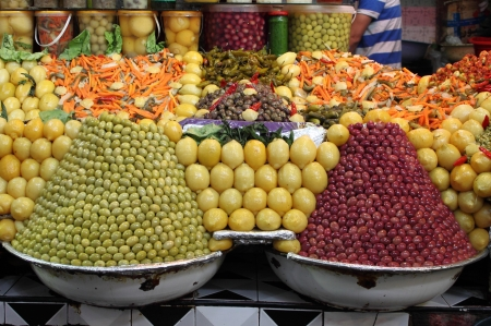 Market stall selling fresh olives and bottled food in Marrakech, Morocco photo