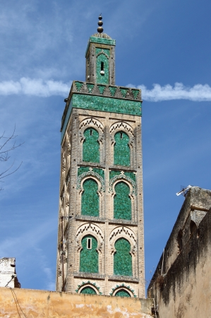 Green tiled minaret of the Mosque Sidi Ahmed Tijani in Fes, Morocco Archivio Fotografico