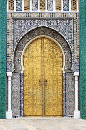 Fes, Morocco - May 15, 2013: Golded door of Royal Palace