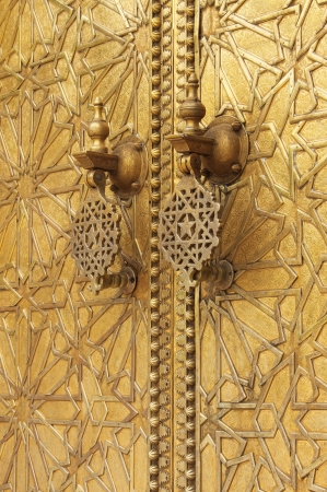 The golden door knockers of the Royal Palace in Fes, Morocco photo
