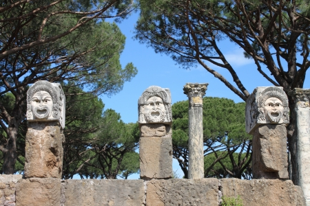 Satiric masks in Ostia Antica, the old Harbour of Rome, Italy
