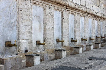 cami: Fountain for ablutions in Yeni Cami Mosque  Istanbul, Turkey