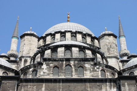Domes of Yeni Cami Mosque in Istanbul, Turkey photo