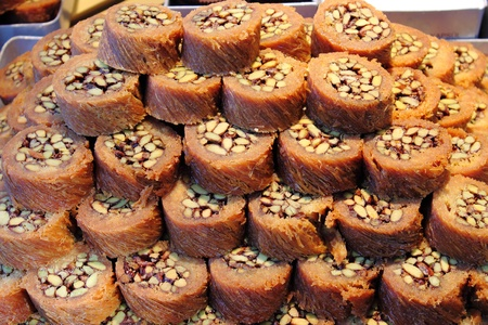 fillo: Tray of Burma Baklava, the traditional turkish sweet made with shredded fillo dough wrapped around a pistachios Stock Photo