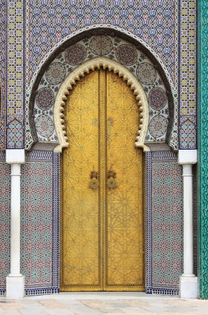 Golded door of Royal Palace in Fes, Morocco photo