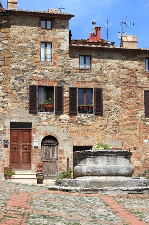 Medieval square with water well in Castiglione d Stock Photo