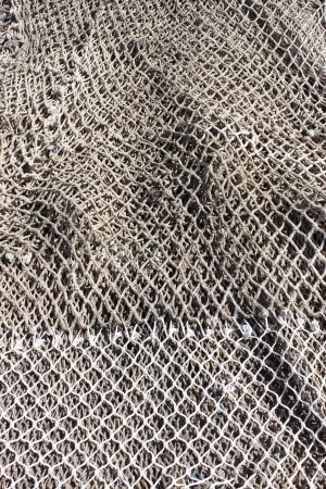 Fishing nets stretched in a port photo