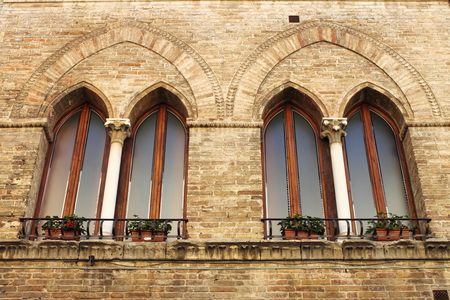 Medieval windows in San Gimignano in Tuscany, Italy photo