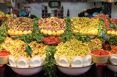 Market stall selling fresh olives in Marrakech, Morocco photo