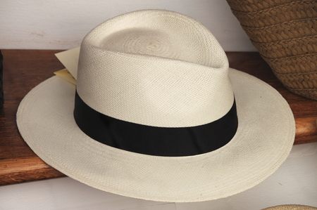 Panama hat for sale in a market stall 스톡 콘텐츠