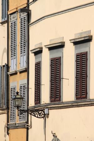 Renaissance windows with closed jalousies photo