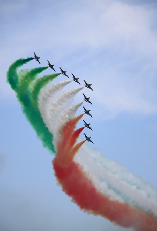 ROME - JUNE 29  The italian acrobatic team Frecce Tricolori perform at the Rome International Air Show on June 29, 2014 in Rome, Italy