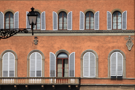 Arched windows with closed shutters photo