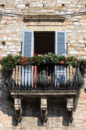 Medieval balcony with flower pots photo