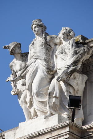 triumphant: Statue of Hermes and the Goddess Roma in Colonna Square of Rome, Italy Stock Photo