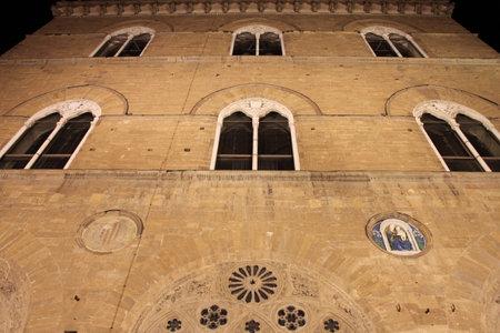 signoria square: Facade of Palazzo Vecchio in Signoria Square of Florence by night. Italy