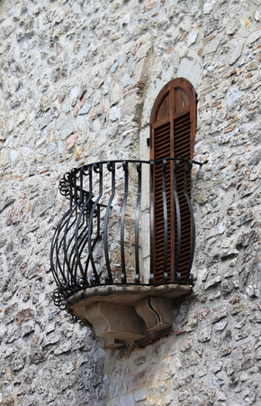 balcony window: Medieval window and balcony with shutters closed Stock Photo