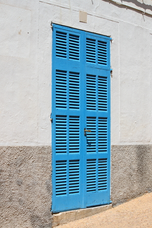baffle: Italian style house entrance with shutters
