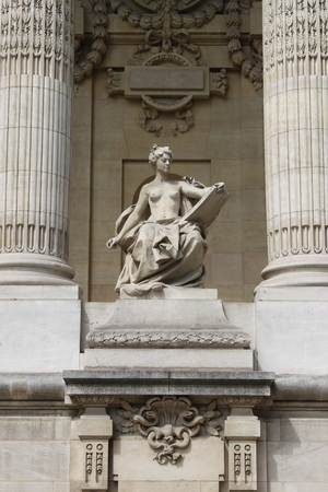 palais: Mytological statue in the facade of Grand Palais of Paris, France