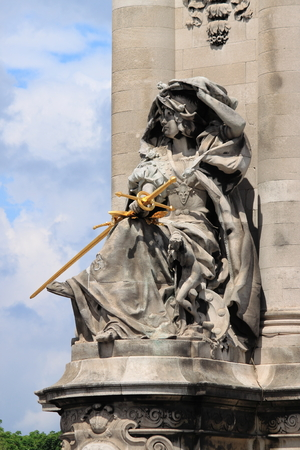 Sculpture in Alexandre III Bridge in Paris, France Stock Photo