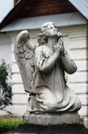Statue of praying angel