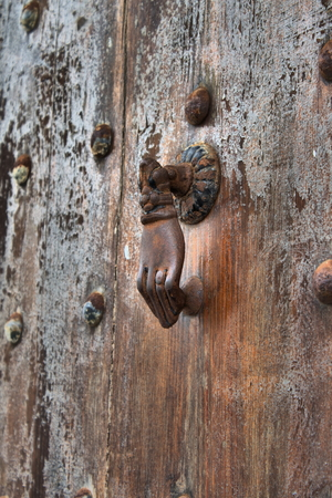 Typical arab style doorknob in a wood door
