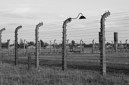 OSWIECIM, POLAND - JULY 23: Barbed wire electrical fence at Auschwitz-Birkenau concentration camp on July 23, 2011 in Oswiecim, Poland. It was the biggest nazi concentration camp in Europe during Worl
