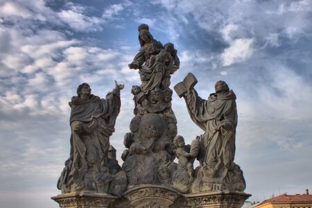 Statue of Madonna, St. Dominic and St. Thomas Aquinas on Charles Bridge in Prague, Czech Republic