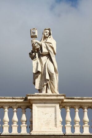 Statue on top of the colonnade of Saint Peter Basilica. Rome, Italy 스톡 콘텐츠