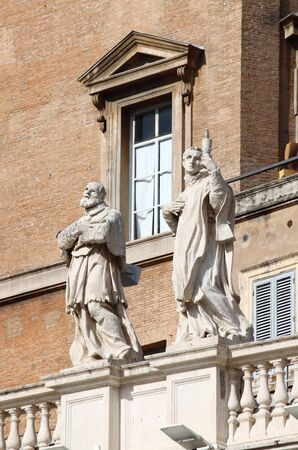 Statues on top of the colonnade of Saint Peter Basilica. Rome, Italy