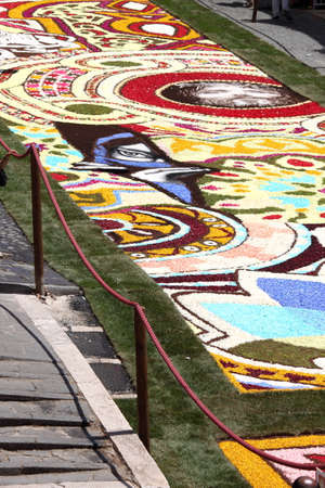 GENZANO, ITALY - JUNE 18: Floral Carpet in the Main Street on June 18, 2017 in Genzano, Italy. This event takes place every year and almost 350.000 flower petals were used this year Editoriali