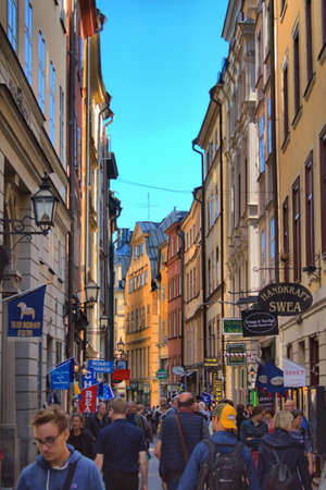 Stockholm, Sweden - August 26, 2017: The long Vasterlanggatan, the central shopping street of Gamla Stan in Stockholm. Gamla Stan is the well-preserved old town centre of Stockholm