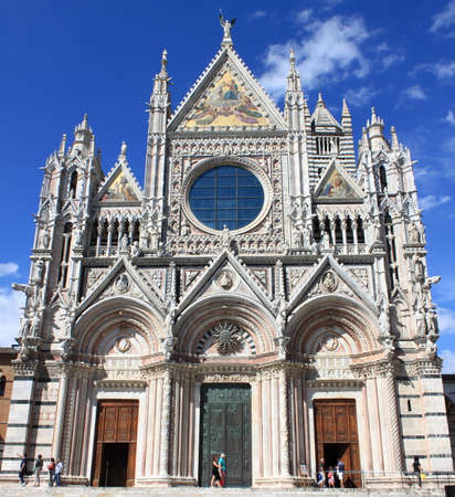 Siena, Italy - June 29, 2018: Facade of Siena Cathedral in Tuscany, Italy